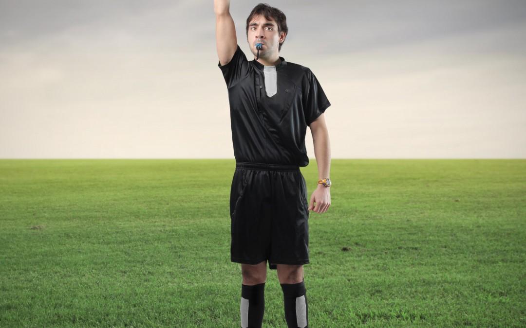 Image d'un arbitre annonçant l'échec et le rejet